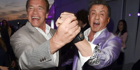 Sylvester Stallone and Arnold Schwarzenegger dance together